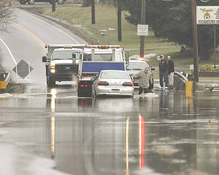 A vehicle had to be towed out of water that flooded West South Range Road (state Route 165) in Beaver Township on Monday.