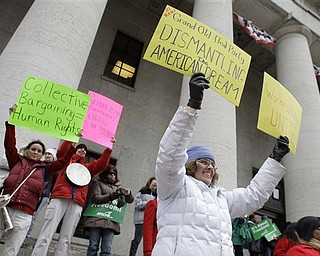 Margo Kernen, right, of Kent, protests against a bill at the Ohio Statehouse Saturday, Feb. 26, 2011, in Columbus, Ohio, that would strip public employees of collective bargaining rights.