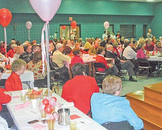 An evening for Valentines: The annual Valentine's Day dinner and entertainment took place at the Ursuline Center in Canfield. A capacity crowd of nearly 200 filled the center's auditorium for dinner provided by The Broad Street Diner in Canfield, for a performance by Tom Solich on the piano and a performance of the One Voice ensemble from Ursuline High School in Youngstown.