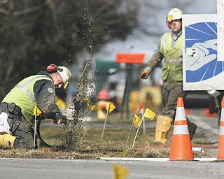 Dominion East Ohio workers and safety officials hustle to locate and shut off gas valves Tuesday afternoon on Hitchcock Road in Boardman.