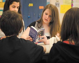 "Jessica Weetman, 12, looks through her copy of ""Freak the Mighty,"" by Rodman Philbrick during a literature circle Tuesday afternoon. Students say they like having the option to choose what they read in class."