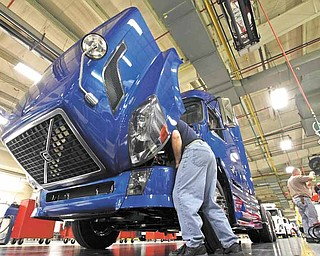 In this Jan. 26, 2011 photo, a worker does a final inspection of a truck on the Volvo assembly line at the plant in Dublin, Va. U.S. manufacturers expanded at the fastest pace in nearly 7 years last month, a sign that factories are still leading the economic recovery. (AP Photo/Steve Helber)