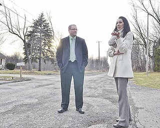 Sherry Froelich discusses the condition of Webb Road in front of her home with Austintown Township Trustee Jim Davis.