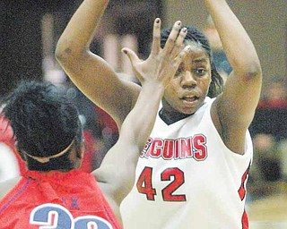 YSU's Brandi Brown gets past UIC's Cree Nix during first half action Thursday.