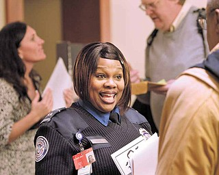 In this March 1, 2011 photo, TSA lead officer Terri Spann recruits workers at a job fair in SeaTac, Wash. The number of people requesting unemployment benefits last week plunged to a nearly three-year low, bolstering hopes that companies will hire more this year.