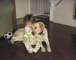 "Michalea and Bella Roberts of Bowie, Md., share a sweet moment. They are the granddaughter and ""granddog"" of Thomas and Joanne Roberts of Canfield."