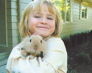 Grace Katherine, daughter of Bethany Paulin of New Middletown, proudly shows off her bunny, Alice.