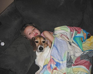 Brelyn Bower of Austintown relaxes with her dog Trinity. They're both 5 1/2 years old. Brelyn is the daughter of Brandon and Jackie Bower, who sent in the photo.