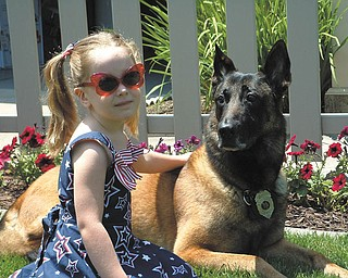 Veronica Cionni hangs out with Robby, a retired Boardman police dog who has been her best friend since she was born. She is the daughter of Brian and Krissie Cionni of Poland.