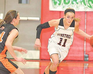Struthers' Katelyn Ardale (11)  heads down court as Jenn Bjelac  (14) plays defense Monday night in Struthers.