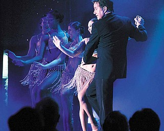 "In a March 2, 2011 photo, French singer Yoland Sirard dances with a costumed dancer during one of the performances in the show, ""Moonshine Follies"" at Resorts Casino Hotel, in Atlantic City, N.J. This year Atlantic City is reaching back to the past to bring back stage shows as a way to drtaw more customers as it struggles with competition all around it."
