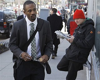 Baltimore Ravens cornerback Domonique Foxworth , left, arrives for football labor negotiations, Friday, March 4, 2011, in Washington. (AP Photo/Alex Brandon)
