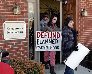 Cathy Lewis, right, and daughter Krista Lewis, second right, from Clear Mountain Church in Williamsburg, Ohio exits John Boehner's district office in West Chester Township, Butler County, Ohio Monday, March 7, 2011 after talking with staff about defunding Planned Parenthood. Seven members of the D.C.-based Operation Rescue/Insurrecta Nex rallied in front of Boehner's office to ask the Speaker of the House to defund Planned Parenthood in the upcoming continuing resolution.
