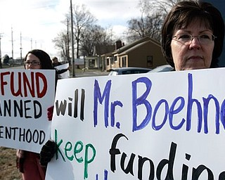 Krista Lewis, left, and Cathy Lewis from Clear Mountain Church in Williamsburg, Ohio protest the federal funding of Planned Parenthood Monday, March 7, 2011 in front of John Boehner's district office in West Chester Township, Butler County, Ohio. Seven members of the D.C.-based Operation Rescue/Insurrecta Nex rallied in front of Boehner's office to ask the Speaker of the House to defund Planned Parenthood in the upcoming continuing resolution.