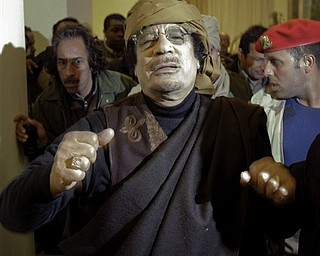Libyan Leader Moammar Gadhafi arrives at a hotel to give television interviews in Tripoli, Libya Tuesday, March 8, 2011.