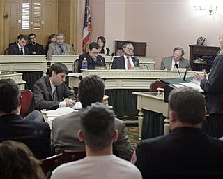 Republican Sen. Shannon Jones, right, testifies before house members on a committee regarding Senate Bill 5 Tuesday, March 8, 2011, in Columbus, Ohio.