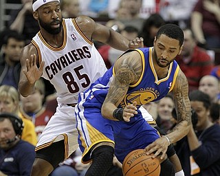 Cleveland Cavaliers' Baron Davis (85) defends Golden State Warriors' Acie Law in the second quarter of an NBA basketball game Tuesday, March 8, 2011, in Cleveland.