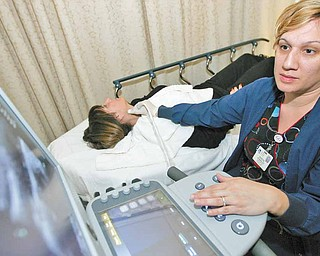 Sharon Gonzalez, Vascular Lab Technician at The Valley Hospital in Ridgewood, New Jersey, conducts a carotid ultrasound on Linda Pollack, Monday, January 24, 2011. Gonzalez used a Sonix Touch Ultrasound system and a grey scale imaging screen with zooming capabilities.