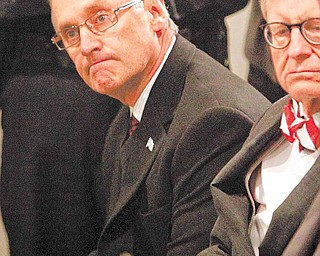 Ohio State football coach Jim Tressel, left, sits next to E. Gordon Gee, Ohio State University president, during a news conference Tuesday, March 8, 2011, in Columbus, Ohio. Ohio State suspended Tressel for two games and fined him $250,000 for violating NCAA rules by failing to notify the school about information he received involving two players and questionable activities involving Buckeye memorabilia. Tressel also will receive a public reprimand and must make a public apology.