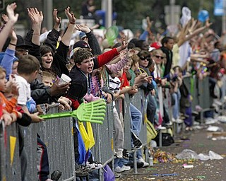Parade-goers reach for trinkets as the Knights of Revelry toss beads to parade-goers gathered along Government Street in Mobile, Ala., as Mardi Gras comes to a conclusion along the Gulf Coast Tuesday, Mar. 8, 2011.