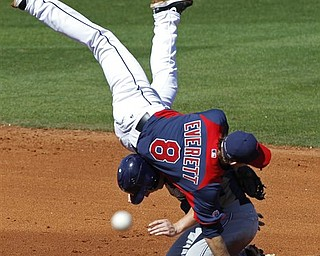 Cleveland Indians shortstop Adam Everett flips over San Diego Padres' Aaron Cunningham after a force out at second, but fails to make the double play during the fifth inning a spring training baseball game in Goodyear, Ariz., Wednesday, March 9, 2011. San Diego Padres' Anthony Rizzo was safe at first.