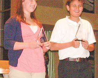 Madeline Graziano and Andrew Brockway, both seventh-grade students at Holy Family School in Poland, achieved the top honors at the school's 2011 science fair.
