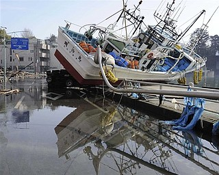 A fishing boat sits inland in Kesennuma, northern Japan Monday, March 14, 2011 following Friday's massive earthquake and the ensuing tsunami.