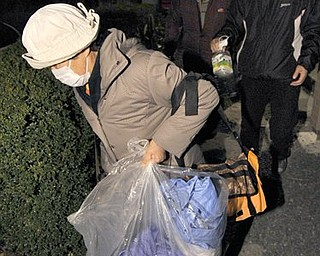 Residents in Iwaki, northern Japan evacuate after the news of a third explosion at the Fukushima Dai-ichi nuclear power, Tuesday, March 15, 2011 following Friday's massive earthquake and the ensuing tsunami.