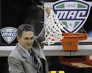 Akron coach Keith Dambrot waves the net after Akron won the NCAA college Mid-American Conference championship 66-65 over Kent State in overtime Saturday, March 12, 2011, in Cleveland.