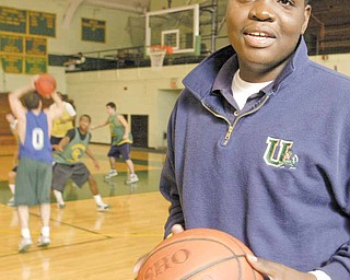 Former Ursuline basketball player Jordan Dubose stands on the sidelines as the Irish practice Monday at Ursuline High School.