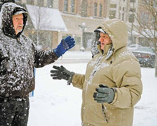 Even on this morning of Feb 25, 2011, George Prvonozac of Warren and Dan Spithaler of Howland walk through a snow storm and continue their prayers.
