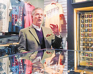 "In this photo made on Thursday, March 10, 2011, David Warfel, the director for global marketing for the Zippo Manufacturing Co., stands in front of a display for Zippo clothing in their model storefront at the company headquarters in Bradford, Pa. With pressure increasing on folks not to smoke, Zippo Manufacturing Co. is hoping to capitalize on its brand by offering a wider variety of products _ from watches to leisure clothing to cologne _ through kiosks and Zippo-brand specialty stores designed to showcase the durable image reinforced by each distinctive lid ""click"" of its brass-encased, lifetime-guaranteed lighters."