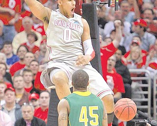 Ohio State Buckeyes forward Jared Sullinger (0) dunks on the George Mason Patriots during the third round of the men's NCAA basketball tournament at the Quicken Loans Arena in Cleveland, Ohio, Sunday, March 20, 2011. The Ohio State Buckeyes defeated the George Mason Patriots, 98-66.