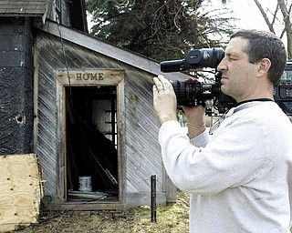 Videographer Andy Fredericks records the demolition of a vacant house on Firnley Avenue on Youngstown's South Side. Blueprint America began more than three years ago and examines the nation's public infrastructure.