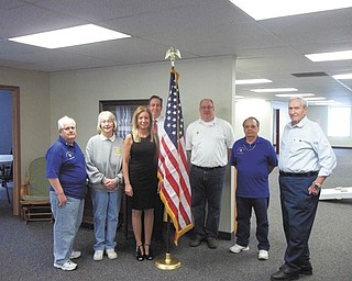 Filling a need: Monsignor Mears Council 3930, Knights of Columbus, from Immaculate Heart of Mary Church in Austintown, recently donated an American flag and flag stand to the Austintown Senior Center, 100 Westchester Drive, Austintown. Involved in the presentation ceremony were, from left, Ivan Croell, K. of C. member; Kay Lavelle, center program director; Lisa L. Oles, Austintown trustee; Bill Adams, center administrator; and Frank Sofranko, Frank Bennet and John Serenko, K. of C. members.
