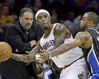 Orlando Magic head coach Stan Van Gundy, left, watches as Magic's Jameer Nelson (14) puts pressure on Cleveland Cavaliers' Daniel Gibson (1) in the fourth quarter of an NBA basketball game, Monday, March 21, 2011, in Cleveland. The Magic won 97-86.