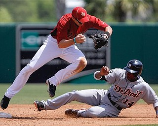 Houston Astros' Tommy Manzella, left, forces out Detroit Tigers' Austin Jackson in the fourth inning of a spring training baseball game Monday, March 21, 2011 in Kissimmee, Fla.