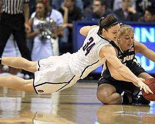 Connecticut's Kelly Faris, left, dives for the ball as Purdue's Brittany Rayburn, right, loses control of the ball during the first half of a second-round NCAA women's college tournament basketball game, Tuesday, March 22, 2011, in Storrs, Conn.
