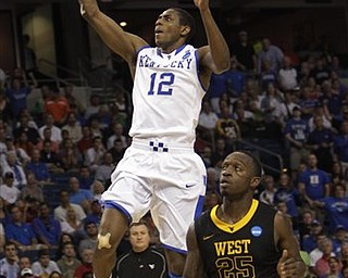 Kentucky's Brandon Knight (12) soares to the basket over West Virginia's Darryl Bryant (25) during the second half of a third-round East regional NCAA basketball game in Tampa, Fla., Saturday March 19, 2011. Kentucky defeated West Virginia 71-63.