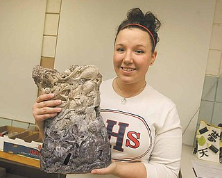 "Fitch High School senior Amber Henik shows off her award-winning ceramics piece ""Global Warming Kills More Than Polar Bears."" Her work will be on display in New York City at the World Financial Center's courtyard gallery through June."