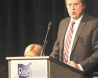 "Tom Humphries, president and CEO of the Youngstown/Warren Regional Chamber, speaks at the chamber's annual meeting and luncheon. The meeting was Thursday at Mr. Anthony's Banquet Center in Boardman. Ron Insana, CNBC senior analyst and commentator and host of the syndicated radio program ""The Insana Quotient,"" was the keynote speaker."