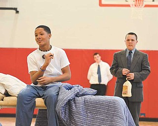 "Ja'Braylon McClendon plays K.C(foreground) and Kenneth Cunningham plays George W. Carver (middle)  in their 8th grade social studies class play, ""K.C.'s Dream."" during the Wilson Middle School's Black History Month program Thursday afternoon."