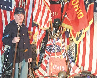 Civil War re-enactor Doug Babyak is a member of the planning committee coordinating quarterly events sponsored by the Sutliffe Museum in Warren that will commemorate the Civil War. The first event in the series will be April 12 at the Eastwood Mall Complex. Here Babyak, of Hartford, displays flags from the war.