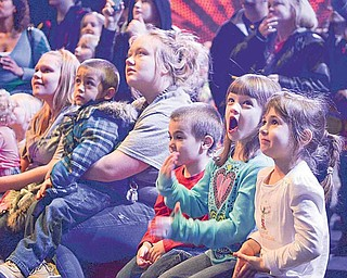 Travis Mills (red), 4, of Canfield, Caiden Smith (blue), 6, of Austintown, and DeeAnna Mills (white), 6, of Canfield, watch a pre-show perfomance Friday night at the Covelli Center.