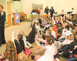 "Loreatha V. Hawkins of Campbell talks to third- and fourth-graders from E.J. Blott Elementary School in Liberty, about following their dreams. That's a message in her fairy tale, ""The Prince and the Musical Castle."""