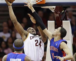 Cleveland Cavaliers' Samardo Samuels (24) shoots over Detroit Pistons' Austin Daye (5) in the first quarter in an NBA basketball game on Friday, March 25, 2011, in Cleveland.