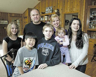 Sean Hiramatsu, 10, of Tokyo enjoys spending time with his host family in Poland. With him at right is Brendan 