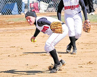 Youngstown State's third baseman Samantha Snodgrass (6) looks to first base to make a throw during a game 