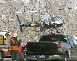 A State Patrol helicopter takes inspectors to check the tracks and the cars after a CSX train carrying ammonia and chlorine derailed near North Center Street in Newton Falls at about 6:45 a.m. Monday.