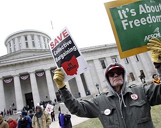 Tom Fagan, of Dayton, protests against Senate Bill 5 at the Ohio statehouse Tuesday, March 29, 2011, in Columbus, Ohio. The bill would strip public employees of collective bargaining rights.